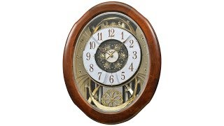 "Magnificent Walnut 21"" High Motion Wall Clock"