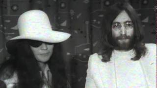 Beatles member John Lennon and new wife Yoko Ono stage a bed-in in Amsterdam