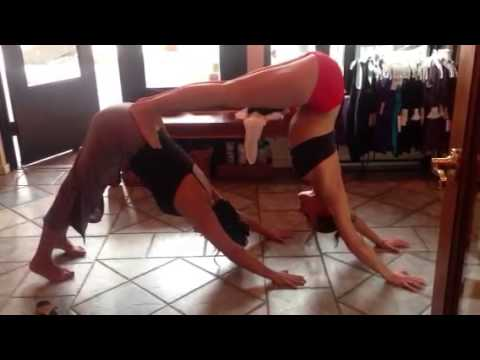 2 Hot Yoga Teachers Demo The Partner Assist For Downward Facing Dog.