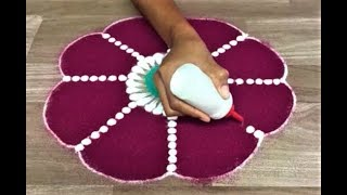 simple flower rangoli design with colour by Gauri for festivals like diwali and dasara