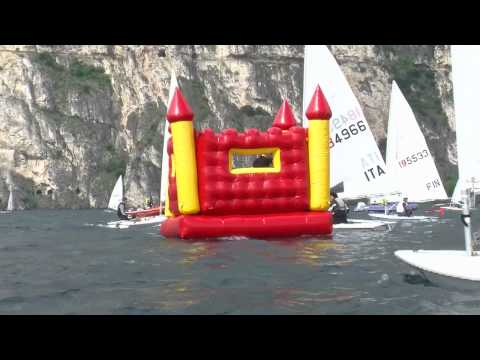 Men Floating In Bouncy Castle Interrupt International Sailing Regatta