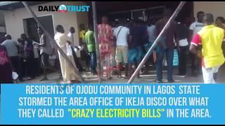 Lagos residents storm Ikeja Disco over ''crazy bills'' - VIDEO