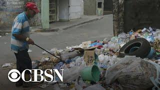 Residents Struggle Amid Venezuela's Economic Collapse