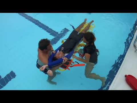 2-Person Spinal Boarding Technique in Shallow Water