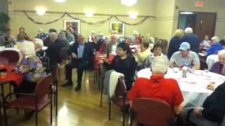 """MCH Choir Sings """"God Bless America"""" at Honor Flight Party"""