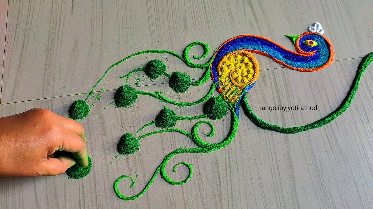 big colorful peacock rangoli design for festivals by jyoti rathod