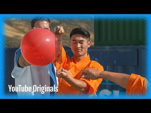 Shaolin Monk Throws a Needle Through Glass with Amazing Speed