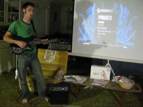Playing <em>Guitar Hero</em> With A Real Guitar