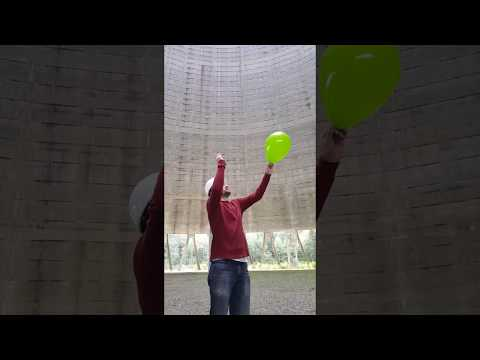 Popping a Balloon Inside a Nuclear Power Plant Cooling Tower