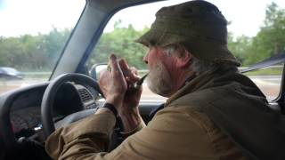 Sir Guy's novel pipe smoking while driving method