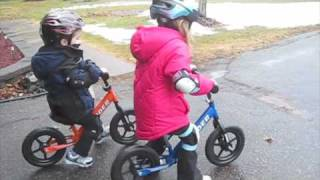Kids on their Strider balance bikes