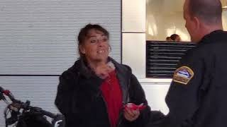 Woman with tennis rackets harassing passages at LAX