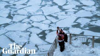 Polar vortex: -46C temperatures as Chicago River turns to ice