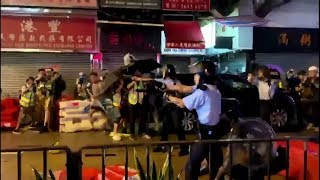 video: Hong Kong police officer 'fires warning shot' amid fresh clashes with protesters