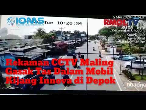 Rekaman CCTV Maling Gasak Tas Dalam Mobil Kijang Innova di Depok