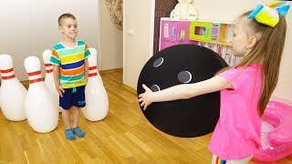 Liza and Tommy play with a Dog Toy and Giant Bowling   Inflatable toys