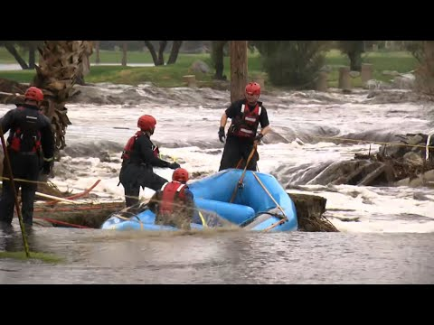 Numerous flood rescues were reported in areas east of Los Angeles as heavy rain pounded California on Thursday. The desert resort city of Palm Springs urged residents to stay where they were because of flooded streets. (Feb. 15)