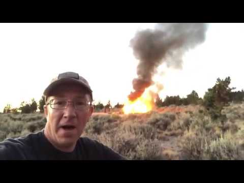 This guy is forced to watch his car burn to the ground in the middle of nowhere and couldn't be a better sport about it.