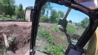 operating CAT 345cl excavator