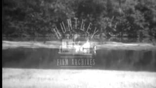 Woman shoots crocodile.  Archive film 93059