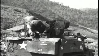 Soldiers fires Quad .50 Caliber Machine Gun targeting on hill and M4 Sherman Tank...HD Stock Footage