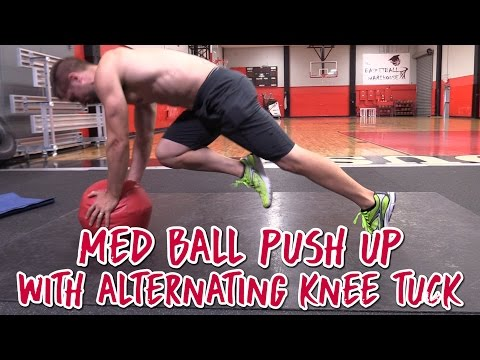 Med Ball Push Up with Alternating Knee Tuck for Tighter Abs