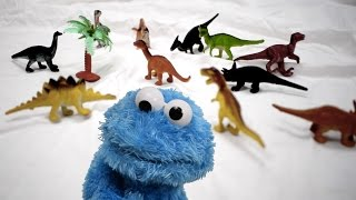 Cookie monster eating dionsaurs