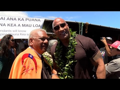 """Actor Dwayne """"The Rock"""" Johnson visited protesters blocking construction of a giant telescope on Hawaii's Big Island on Wednesday. Johnson said he was honored to be there and told a crowd: """"I stand with you."""" (July 25)"""