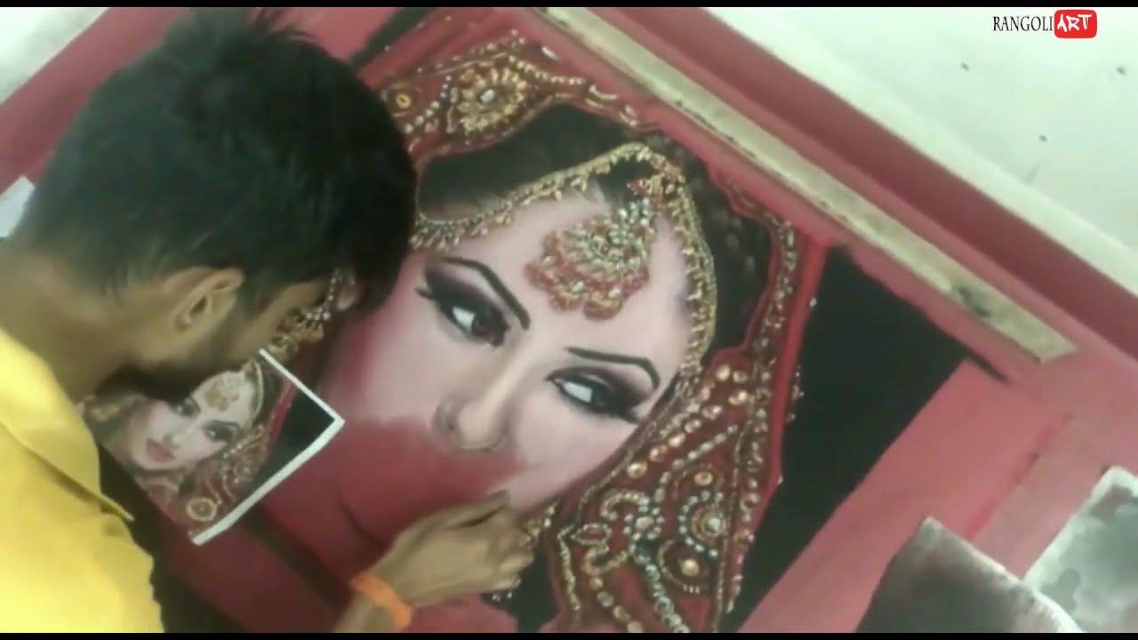 portrait rangoli of a jewellery bride by roshan j patil