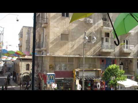 Video Colorful umbrellas float above Jerusalem streets - Taken from the Tmol Shilshom restaurant