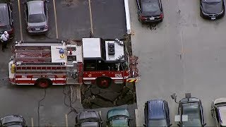 Parking Garage Partially Collapses Underneath Chicago Fire Dept. Engine In South Shore