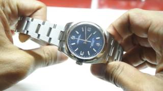 Rolex Oyster Perpetual 116000 36mm Blue. One of the best looking Sports Rolex for small wrists.
