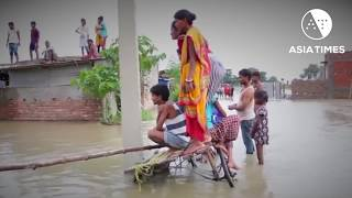South Asia monsoon rains wreak flood havoc
