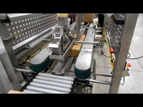 Selladora Sanitaria TBS-100FC XL con estacion manual para doblar las solapas de las cajas