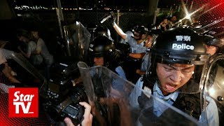 Hong Kong police force back protesters trying to storm parliament
