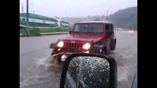 Jeep Driving On Flooded Road Toronto Canada
