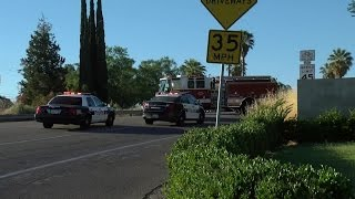 Bakersfield Police Department officer crashes into pickup on Panorama Drive