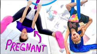 PREGNANT LADY DOES ACROBATS WITH CHILD!