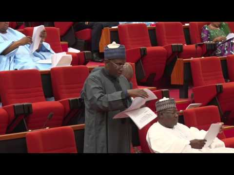 Senator Abu Ibrahim giving a Report of the Joint  Committee on Police affairs, National Security  an