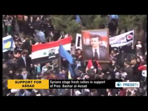 , title : 'Syrians hold rallies in support of Assad government'