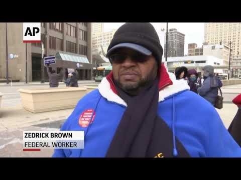 Federal workers in Detroit and Chicago hold rallies denouncing the ongoing government shutdown (Jan. 10)