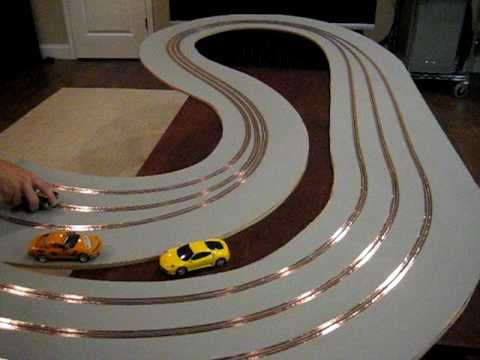 wood slot car track with magnetic primer