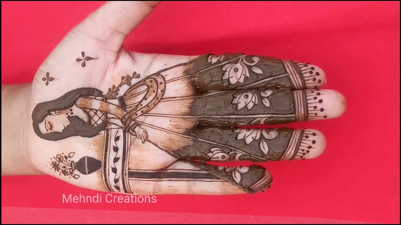 stylish mehndi design drawing a full bride on hand by mehndi creations