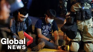 Hong Kong protesters holed up in besieged university surrender themselves to police