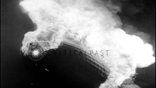 Final flight of the airship Hindenburg, then it bursts into flames when landing HD Stock Footage