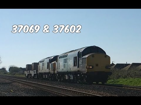 DRS 37069 & 37602 pass Prestatyn with nuclear flasks 7th Apr…