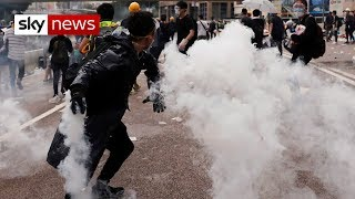 Protesters in Hong Kong battle police over extradition bill