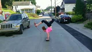 Girl does handstand on a skateboard with a bow and arrow #3 - 997171-3