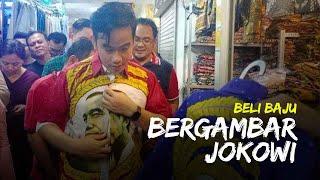 Blusukan di Pasar Tekstil BTC Solo, Gibran Membeli Baju Batik Merah Bergambar Wajah Jokowi