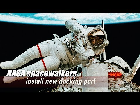 Live: NASA spacewalkers install new docking port NASA宇航员太空行走装适配器